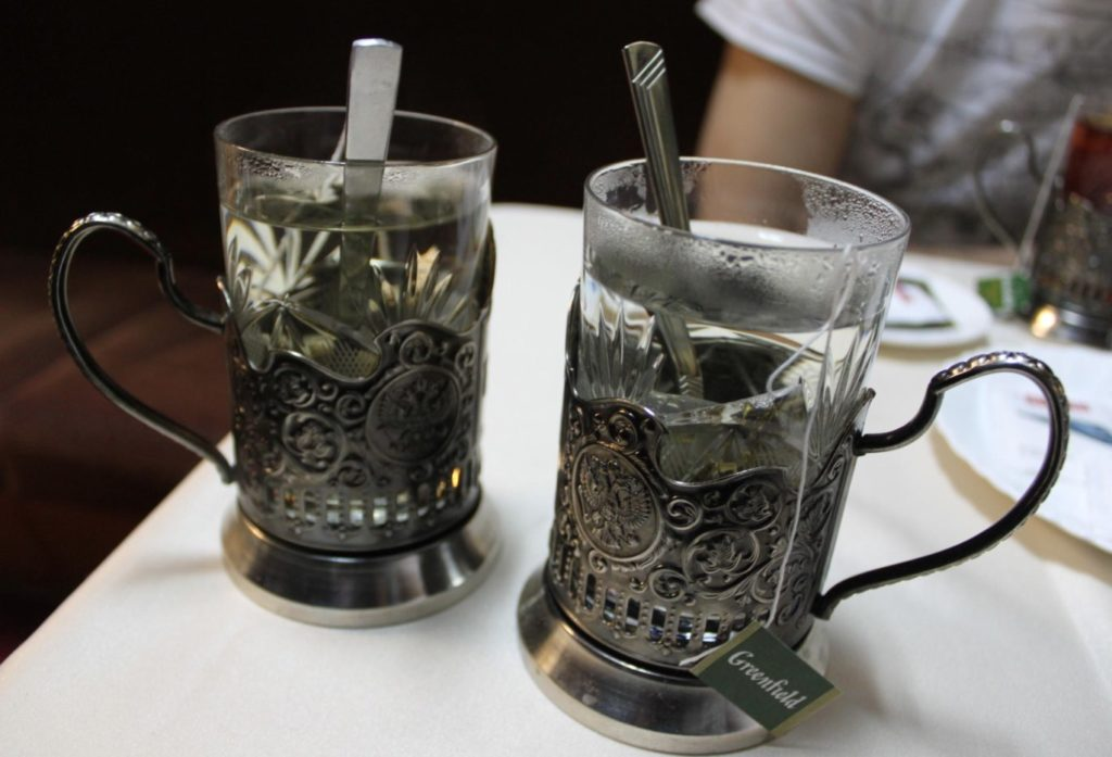 Russian tea by train with metal holder glass